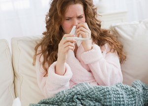 female-suffering-from-a-cold-flu-pic-getty-images-544468555